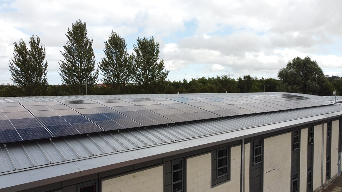 solar panel installation on roof of building